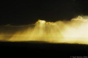 sun_rays_through_dark_rain_clouds_a8v91662