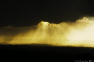 sun_rays_through_dark_rain_clouds_a8v91662